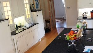 granite worktops and white cupboards