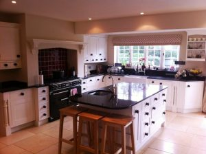 country kitchen with range cooker and central sink